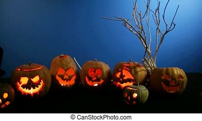 Group Of Carved Halloween Pumpkins Standing In A Row - This...