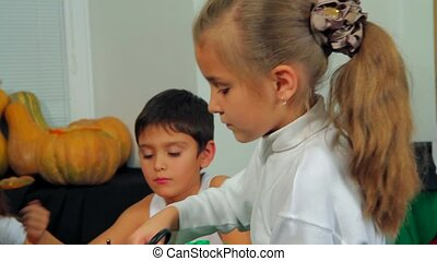 Group Of Children Crafting Preparing For Halloween Party -...