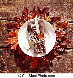 Decorative colorful autumn table setting with a place mat...