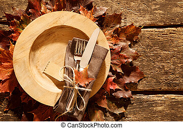 Colorful autumn or fall place setting with a knife, fork and...