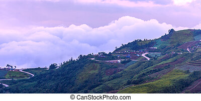 Panoramic view of winding road on mountain with moring foggy.