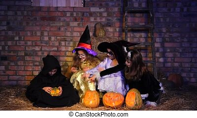 Halloween Little Monster Doing Magic With Pumpkin - In the...