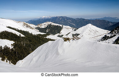 Landscape of snow mountain with blue sky in Mt Hehuan,...