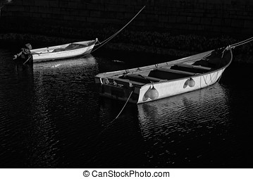 Small fishing boats moored Infrared black and whute
