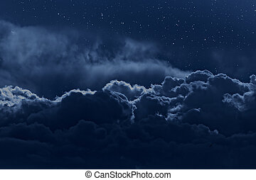 Cloudy night sky - Night sky with stars and strong clouds as...