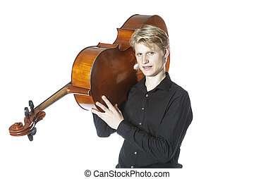 young blond caucasian man carries cello on shoulder in studio against white background