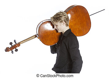 young blond caucasian man carries cello on shoulder in...
