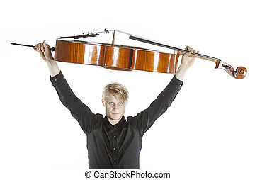 young blond caucasian man holds cello up in the air in...