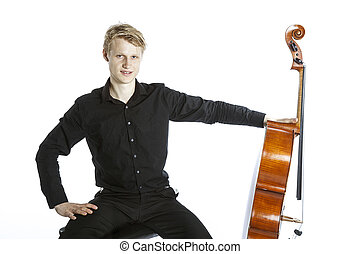 young caucasian man holds cello - young blond caucasian man...