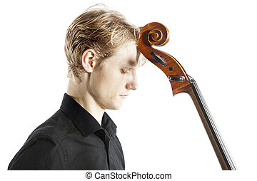 young blond caucasian man holds cello against forehead in...