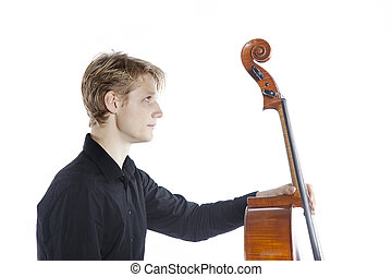 young blond caucasian man holds cello in studio against...