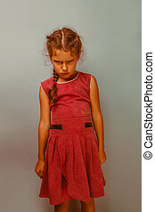 Girl European appearance decade angry frowns blue background...