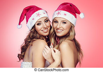 Christmas girlfriends - Girlfriends in Christmas hats on...