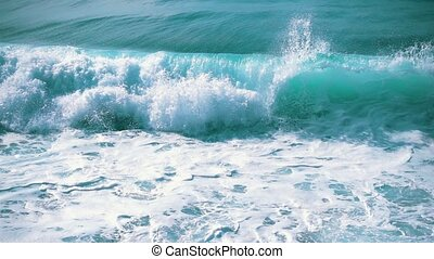 Slow motion Ocean Waves Breaking on Shore, closeup