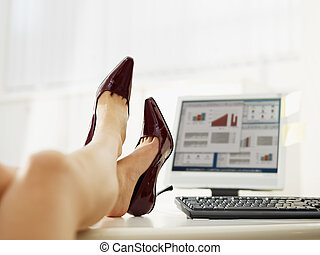 business woman taking off shoes in office. Copy space