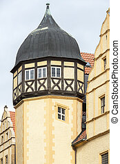 Onion shaped tower of an old half-timbered house in...