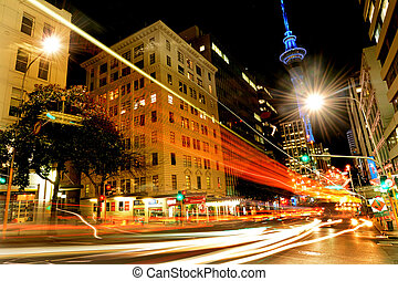 Traffic on Victoria Street in Auckland Downtown at night -...