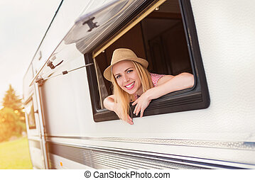 Beautiful woman in a camper van - Beautiful young woman in a...