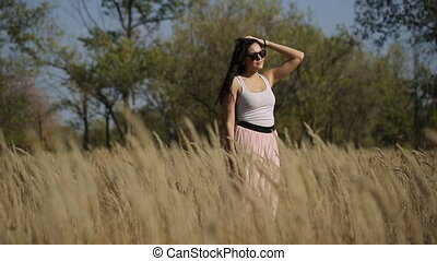 thoughtful girl in a field slow motion - thoughtful girl in...