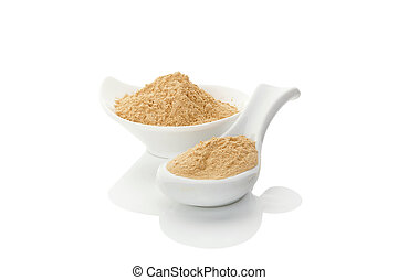 Maca powder. - Maca powder on spoon and in a bowl isolated...