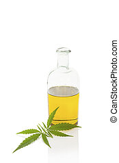Hemp oil. - Hemp oil and cannabis leaf isolated on white...