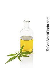 Hemp oil. - Hemp oil and cannabis leaf isolated on white...