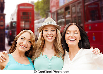group of happy young women over london city street - summer...