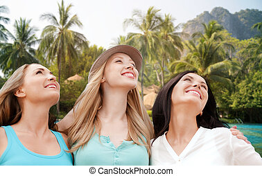 happy young women over resort beach - summer holidays,...