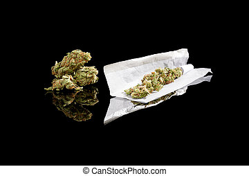 Rolling a cannabis joint - Marijuana bud and cigarette...
