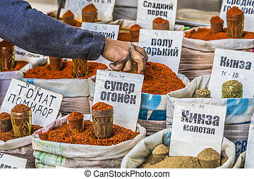 Vivid oriental central asian market with bags full of...