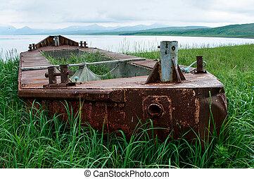 Abandoned boat run aground at island Paramushir, Russia