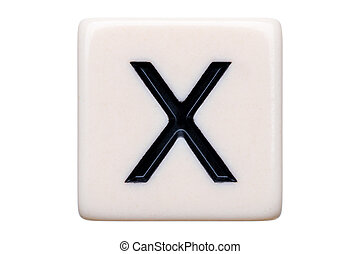 X Tile - A macro shot of a game tile with the letter X on it...