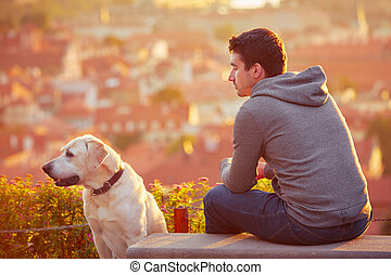 Man with dog at the sunrise - Young man with his dog at the...