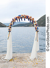 wedding arch decorated with flowers outdoors