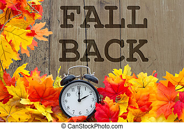 Fall Back Time Change, Autumn Leaves and Alarm Clock with...