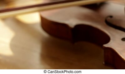 Retro violin Wedding rings lie on vintage violin Violin...