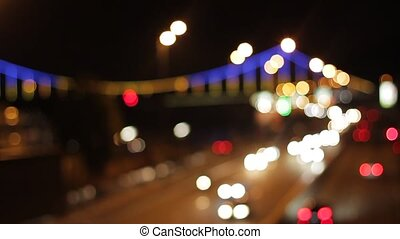 Blurred background of highway. Traffic of a night city. Rush...