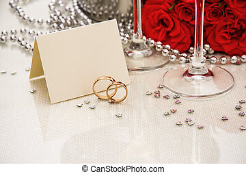 Wedding rings with writing card and champagne, copyspace