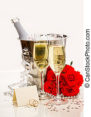 Wedding rings with writing card and champagne as postcard