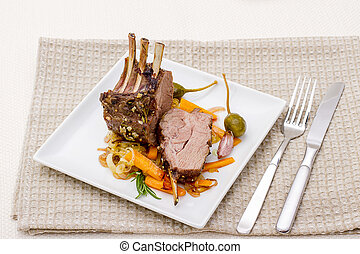 Grilled rack of lamb with carrot onion, garlic and capers