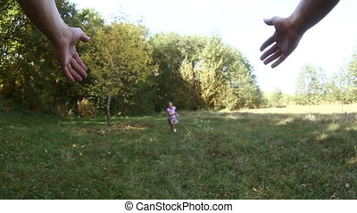 happy girl teen daughter runs to her father twirling hands...
