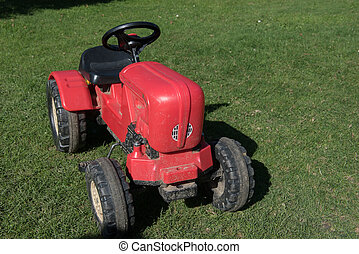 toy tractor standing on the grass