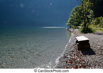 Wooden bench at Koenigssee lake - Wooden bench on shore of...
