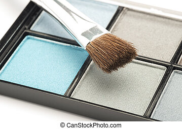 Blue and grey eye make up with a brush