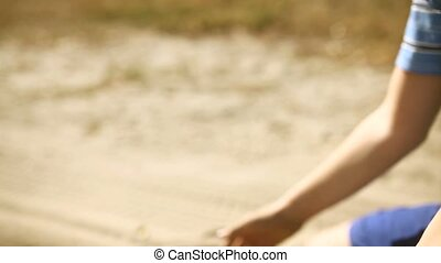 Teen boy big hand pours sand symbol time desert - Teen boy...