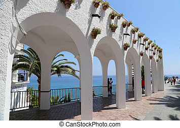 Balcon de Europa and tourists in Nerja, Andalusia, Spain. It...