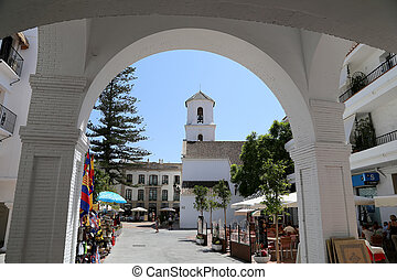 Buildings and tourists in Nerja, Andalusia, Spain. It is on...
