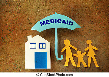 Family Medicaid umbrella - Paper cutout family with house...