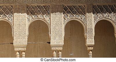 Arches in Islamic Moorish style in Alhambra, Granada, Spain...