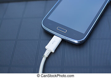 Mobile phone charging with solar energy - charger - Use of...